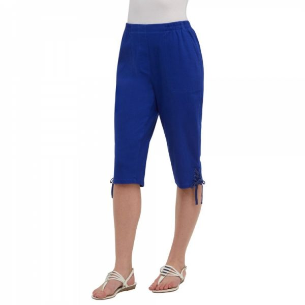 Alia Capris with side pockets, back patch pockets, pull on elastic waistband, lace detail at hem in royal